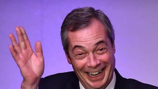 Nigel Farage waves to delegates during the second day of the UKIP spring conference in Margate, Kent, on February 28, 2015.