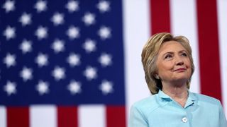 MIAMI, FL - JULY 23: Democratic presidential candidate former Secretary of State Hillary Clinton looks on as her running mate Democratic vice presidential candidate U.S. Sen. Tim Kaine (D-VA) speaks during a campaign rally at Florida International University Panther Arena on July 23, 2016 in Miami, Florida. Hillary Clinton and Tim Kaine made their first public appearance together a day after the Clinton campaign announced Senator Kaine as the Democratic vice presidential candidate.