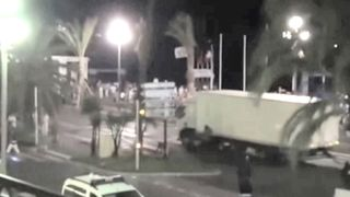 Video of the lorry before it drove into the crowd in Nice, France. They show people attempting to stop the driver before he drives off down the promenade. The pictures don't show the moment when the vehicle hits the crowd.