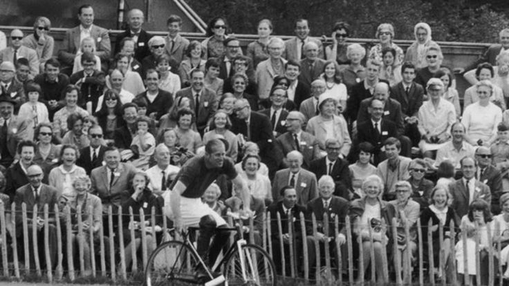 Prince Philip competing in a bicycle polo match at Windsor