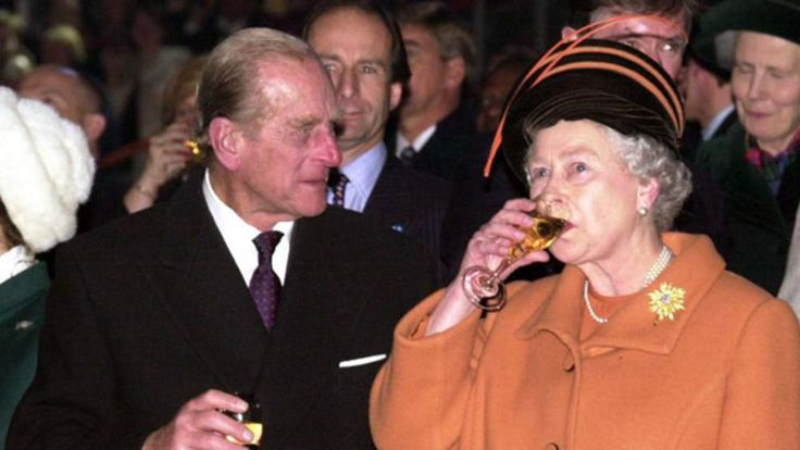 Prince Philip and the Queen toast the new millennium during celebrations at the Millennium Dome in London