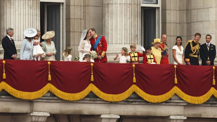 The Duke and Duchess of Cambridge kiss on the balcony of Buckingham Palace on their wedding day