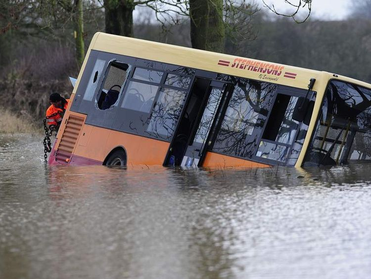 Bus submerged in floodwater in Tollerton.