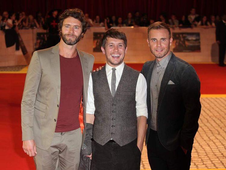 Take That members (L-R) Howard Donald, Mark Owen and Gary Barlow.