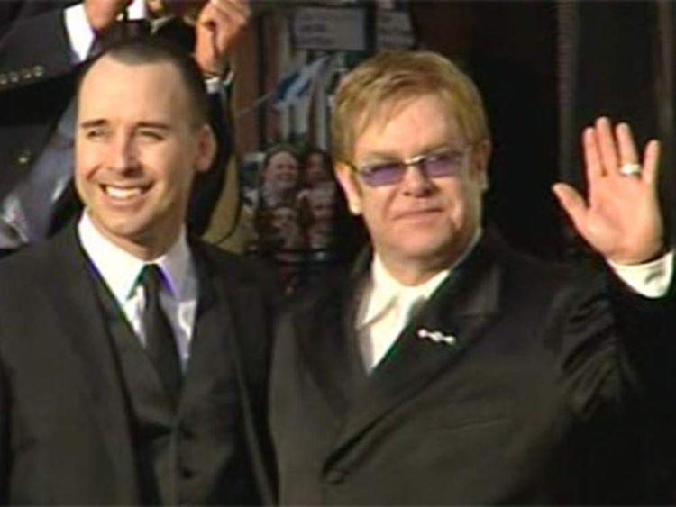 PP Elton John & David Furnish after Elton waves