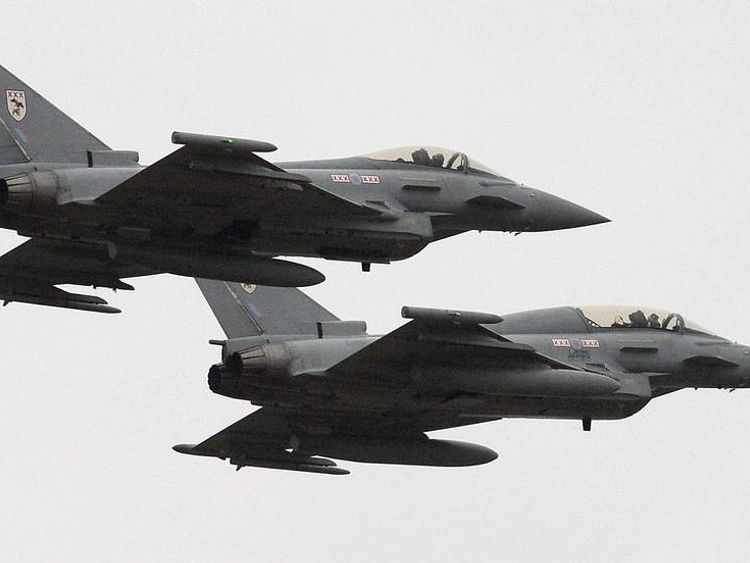 Two British Royal Air Force Typhoon FGR4 aircraft fly over RAF Waddington near Lincoln, England on February 29, 2012, before British Defence Secretary Philip Hammond arrives to observe a London 2012 Olympic Games air security training