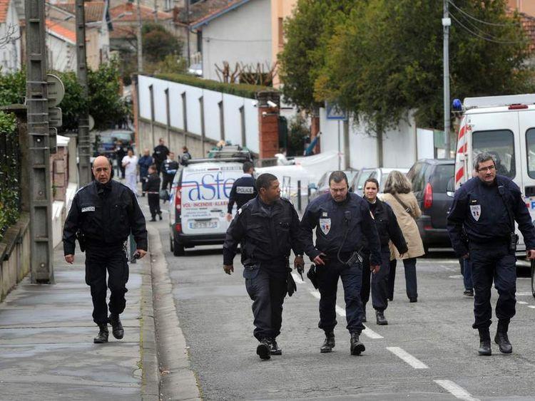 "Policemen people near the ""Ozar Hatorah"" Jewish school"