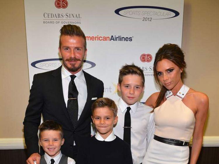 David and Victoria Beckham and sons, Cruz, Romeo and Brooklyn (L-R)