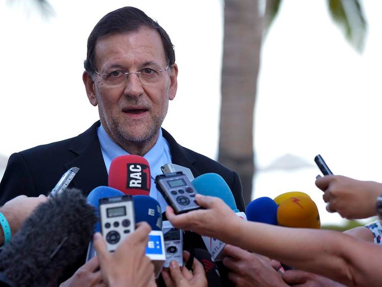 Spanish Prime Minister Mariano Rajoy talks to members of the media upon his arrival at his hotel in Los Cabos on June 17, 2012, on the eve of the G20.