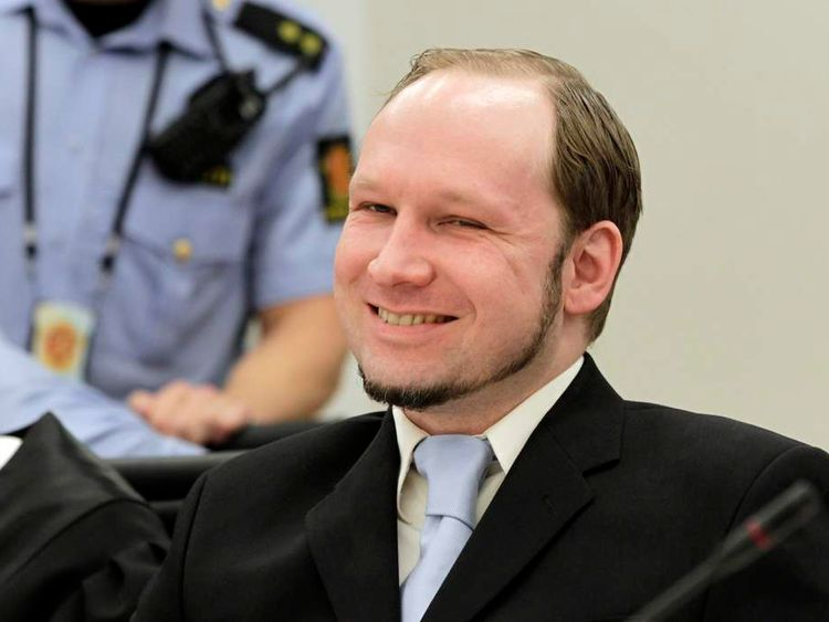 Mass killer Anders Behring Breivik smiles during his trial in room 250 of Oslo's central court on June 21, 2012.