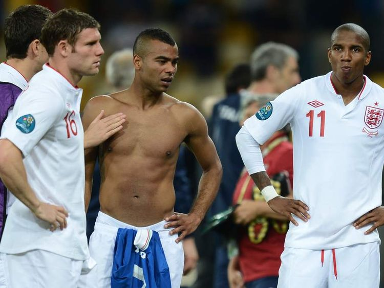 English defender Ashley Cole (L) and Ashley Young walk off the pitch by after being beaten in a penalty shoot out during the Euro 2012 football championships quarter-final match