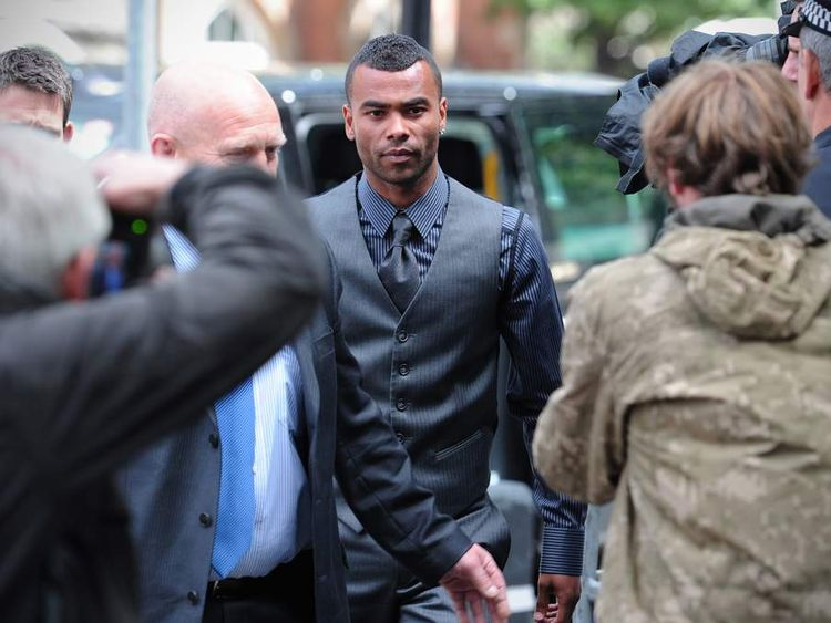 Chelsea and England footballer Ashley Cole (C) arrives to attend the trial of his team-mate John Terry at Westminster Magistrates court in London.