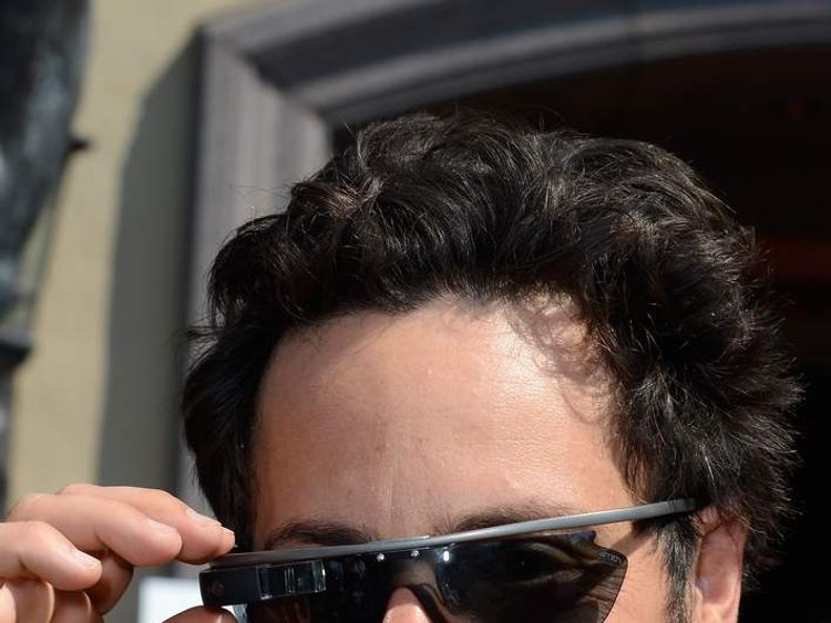 Google co-founder Sergey Brin wears a prototype Project Glass