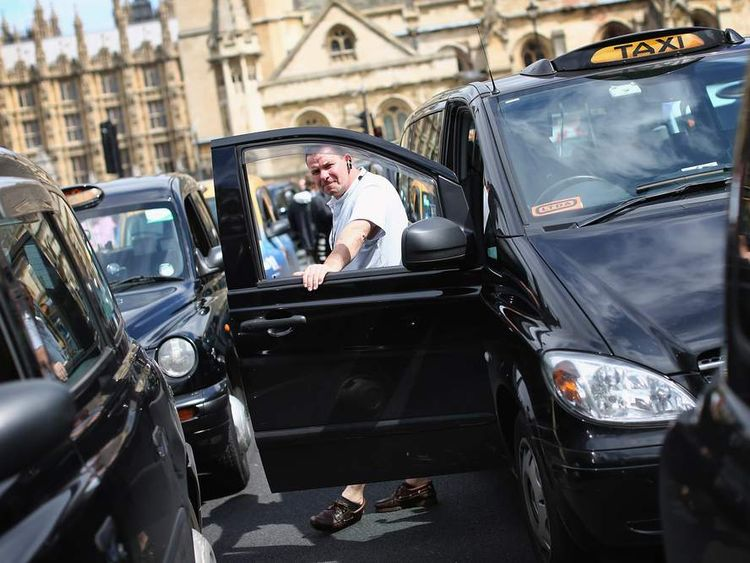 Taxi drivers demonstrate outside the Houses of Parliament on July 17, 2012 in London, England.