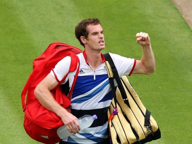 Andy Murray celebrates a tennis win against Switzerland