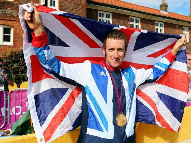 Gold medallist Bradley Wiggins of Great Britain celebrates after the victory