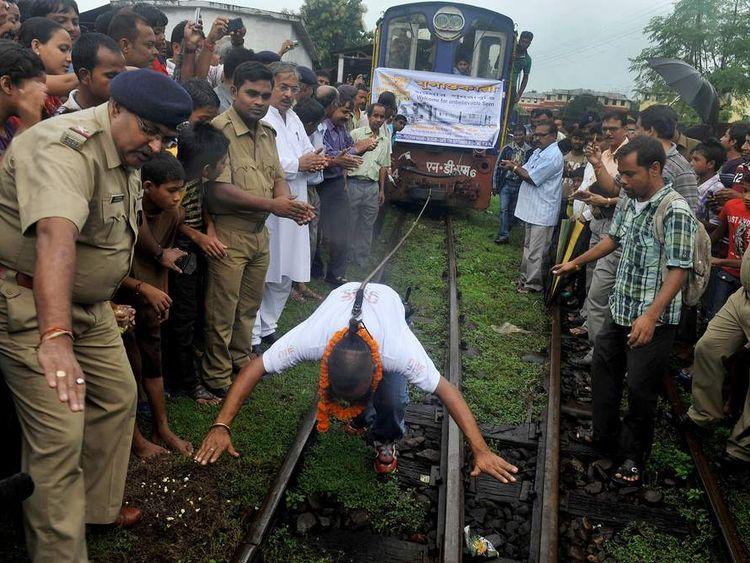 Sailendra Nath Roy pulls train using his ponytail