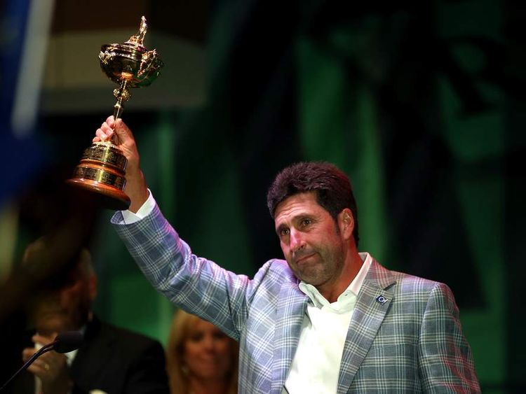 Jose Maria Olazabal holds the Ryder Cup aloft at the closing ceremony