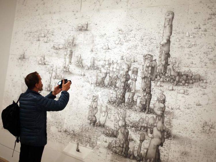 A visitor photographs Turner Prize nominee Paul Noble's 'Villa Joe.