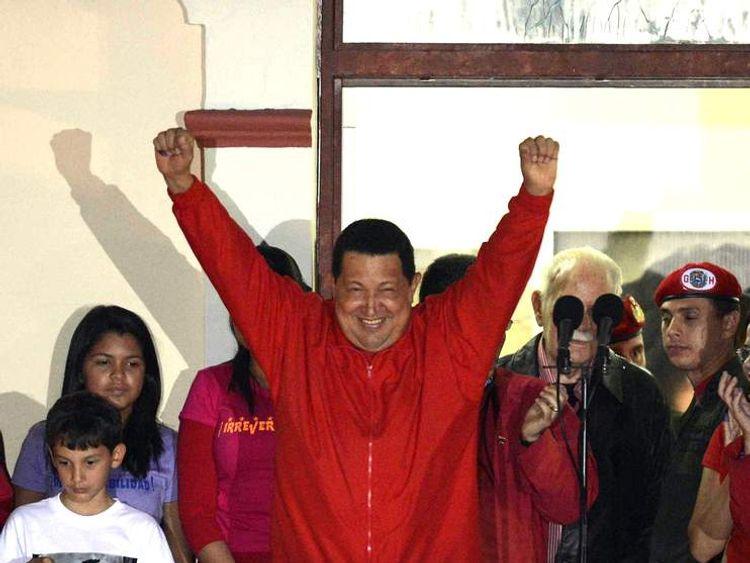 Hugo Chavez Gestures To Supporters