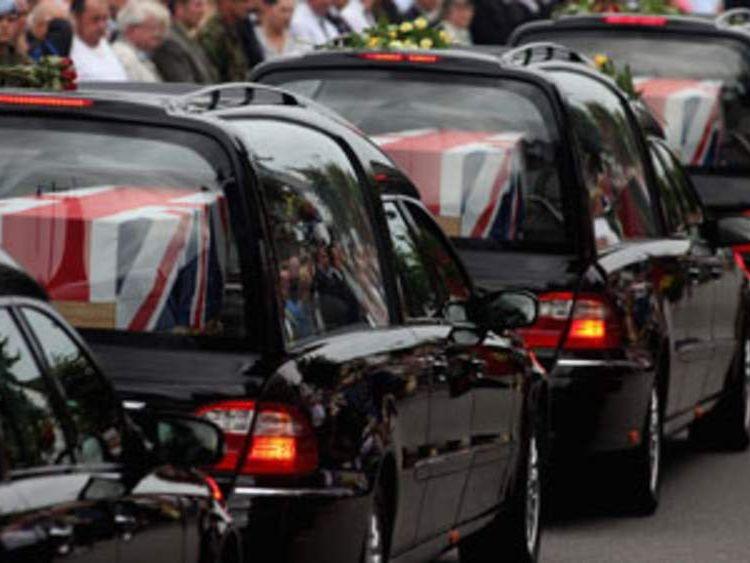 Hearses carrying the bodies of fallen soldiers move through Wootton Bassett