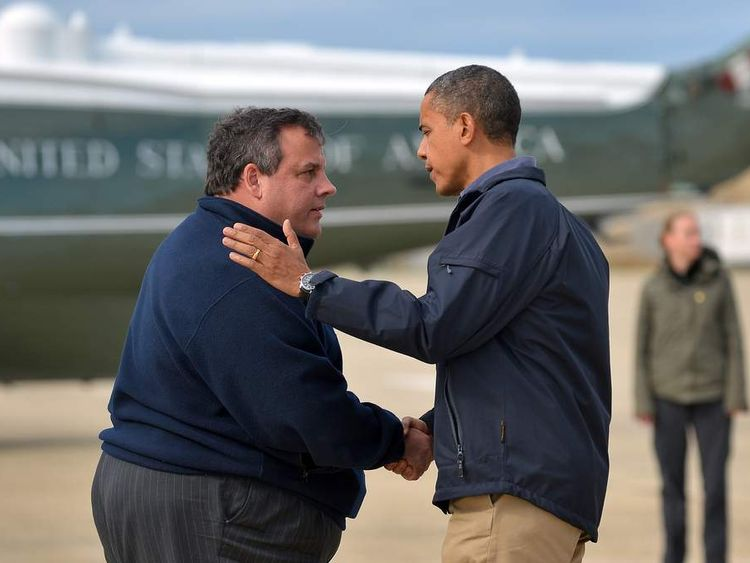 US President Barack Obama (R) is greeted by New Jersey Governor Chris Christie upon arriving in Atlantic City, New Jersey