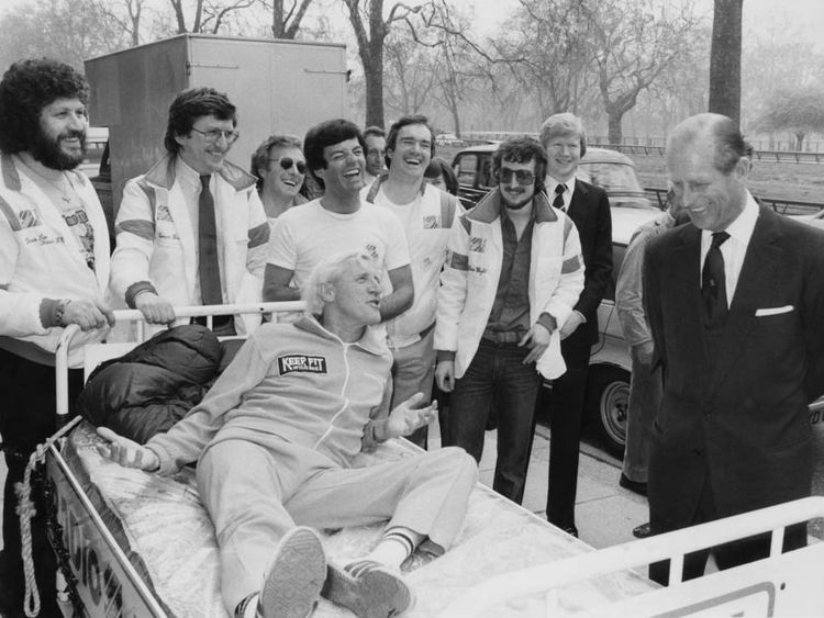 Dave Lee Travis, Jimmy Savile and a number of other former Radio One DJs, talk to the Duke of Edinburgh