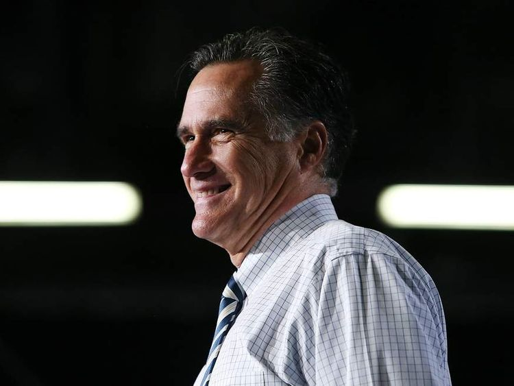 Mr Romney speaks during a campaign rally at the Hy Vee Center on Sunday