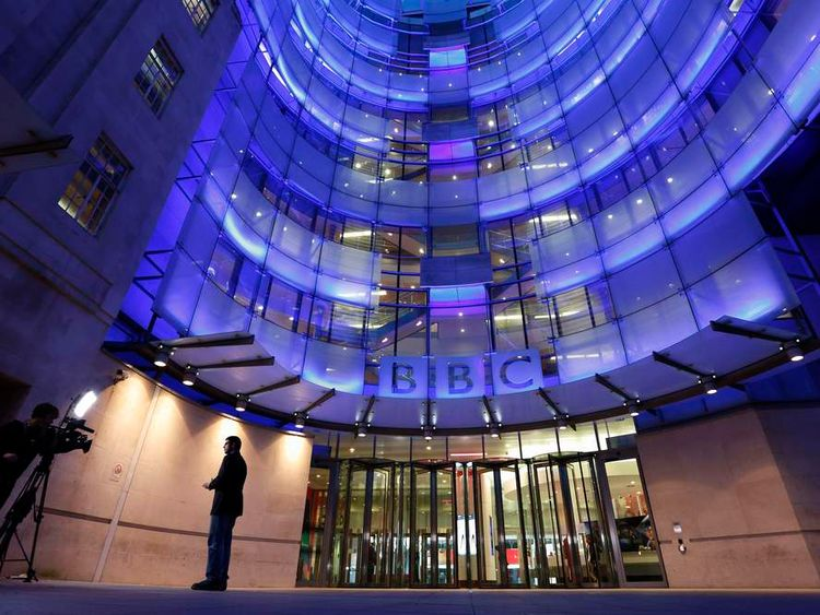 A journalist is seen presenting in front of camera, outside the BBC's New Broadcasting House in central London on November 11, 2012.