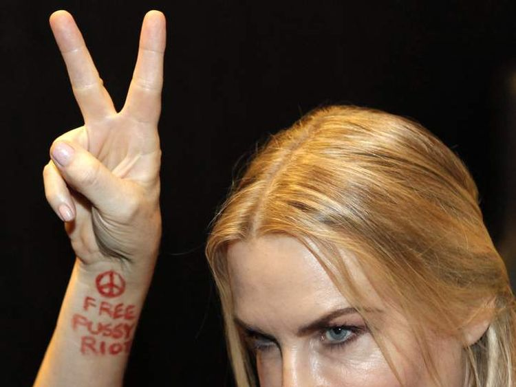 Daryl Hannah shows a slogan on her forearm in support of the two jailed members of feminist punk band Pussy Riot