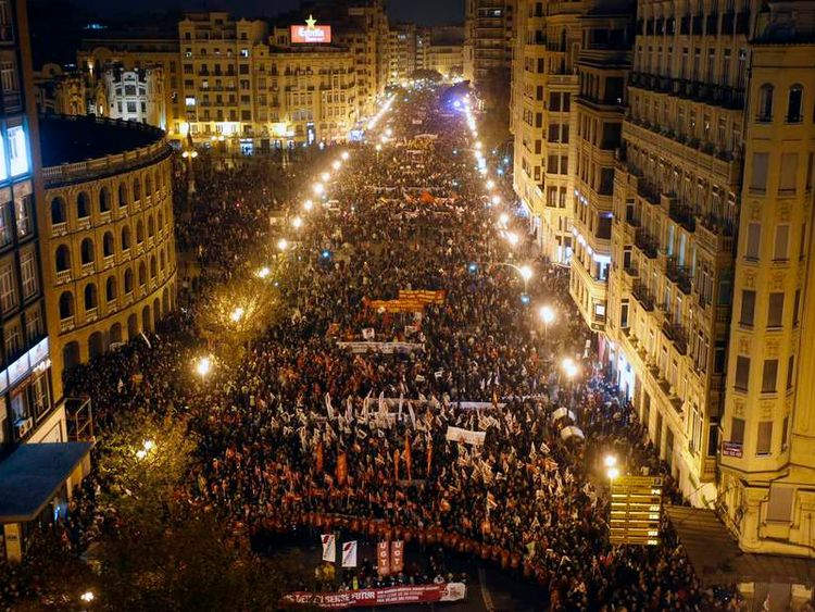 Protesters take part in a demonstration in Valencia