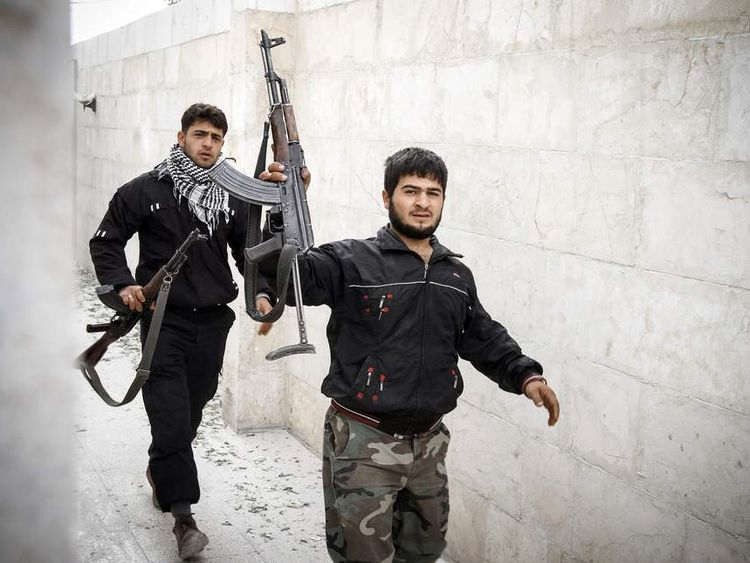 Syrian rebel fighters in Maarat al-Numan