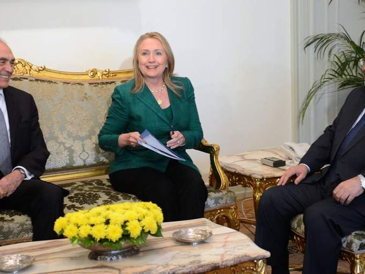 Egyptian President Mohamed Morsi (R) and his Foreign Minister Mohammed Kamel Amr (L) meet with US Secretary Hilary Clinton at the presidential palace in Cairo.