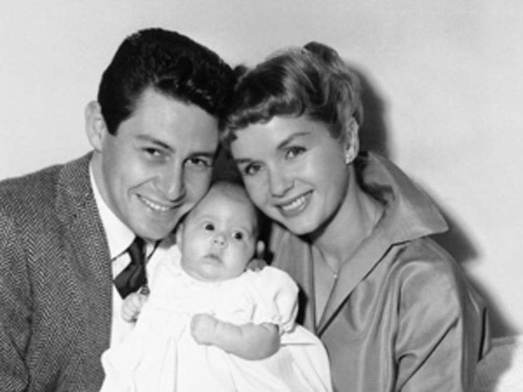 Eddie Fisher and Debbie Reynolds with their daughter, Carrie Frances Fisher, in 1957