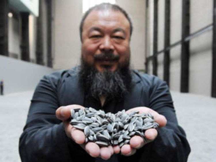 Chinese artist Ai Weiwei with his work Sunflower Seeds