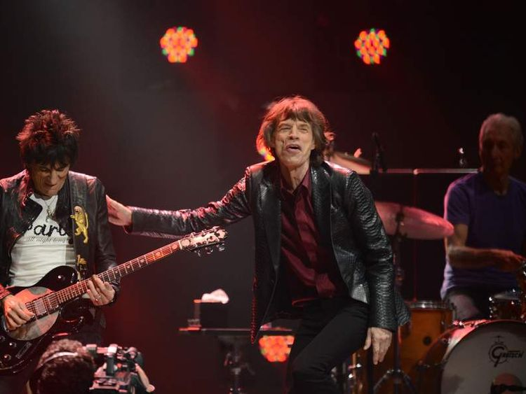 Ronnie Wood, Mick Jagger and Charlie Watts on stage in December 2012