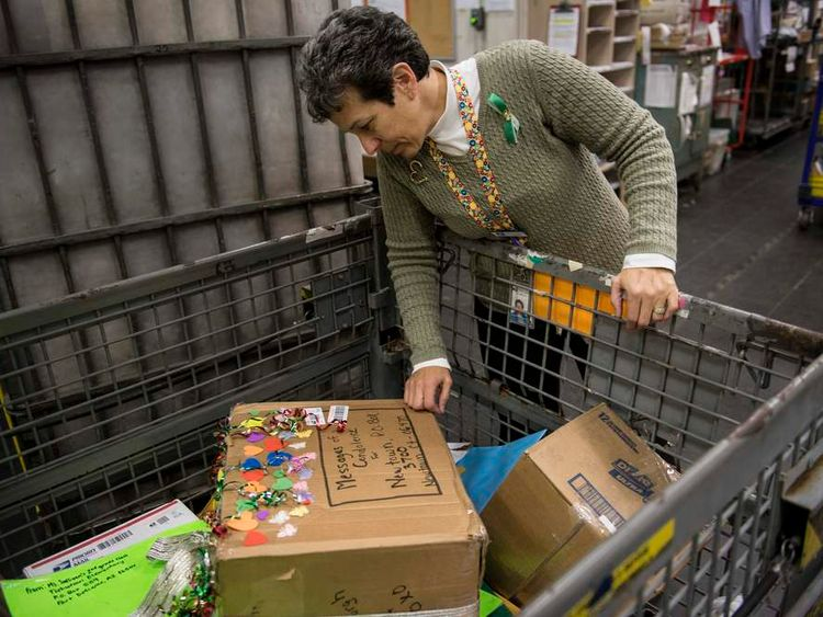 Postmaster Cathy Zieff sorts through some of the parcels and letters sent to Newtown
