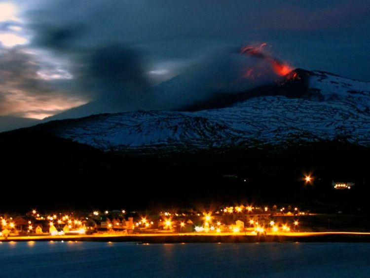 View of the Copahue volcano spewing ashes from Caviahue
