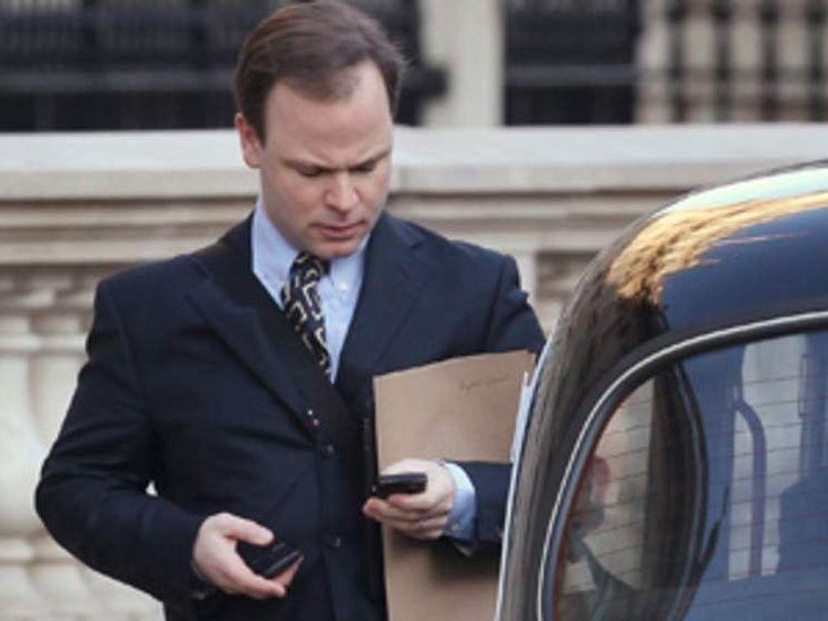 Craig Oliver hailing a taxi
