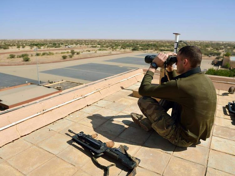 A French soldier uses binoculars at Timbuktu airpor