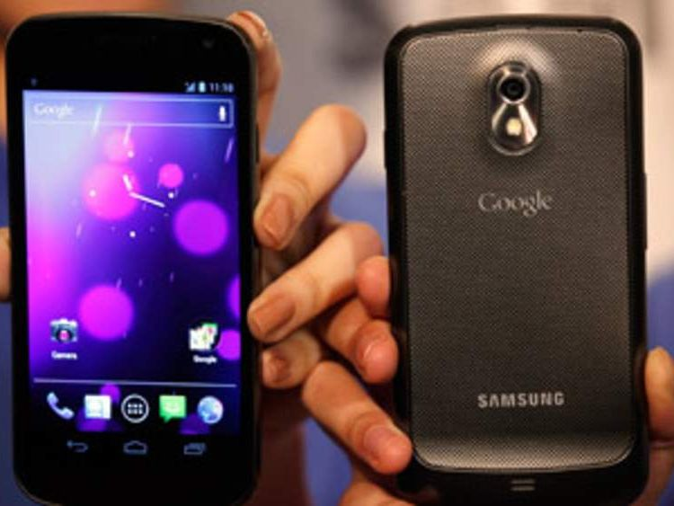 Models pose with the Galaxy Nexus, the first smartphone to feature Android 4.0 Ice Cream Sandwich