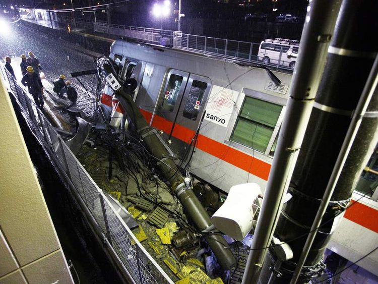 A passenger train of the Sanyo Electric Railway is derailed after the train hit a truck at a level crossing in Takasago city in Hyogo prefecture, western Japan