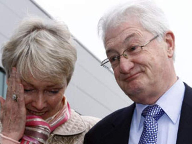 Christopher Tappin, with his wife Elaine, gives a statement outside Heathrow police station