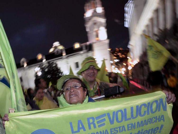 Supporters of Ecuadorean President Rafael Correa celebrate his re-election