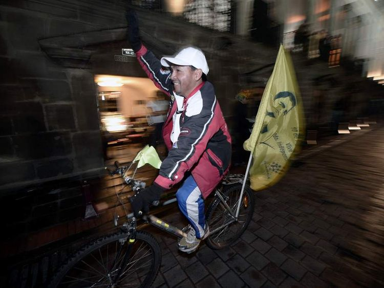A supporter of Ecuadorean President Rafael Correa celebrates his re-election