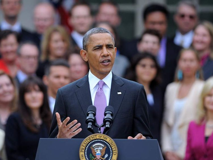 US President Barack Obama speaks during a ceremony to honour National Teacher of the Year Jeff Charbonneau