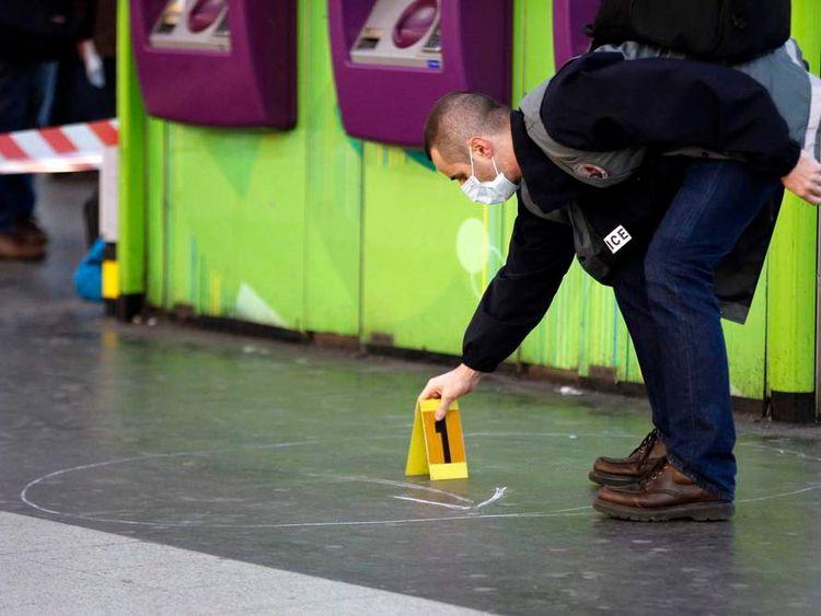Policeman marks evidence