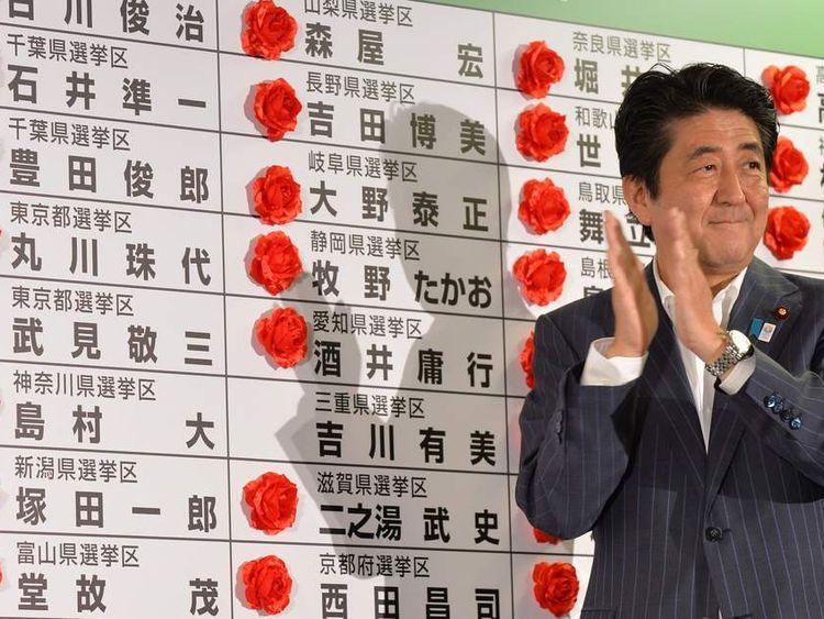 Shinzo Abe celebrates his party's win