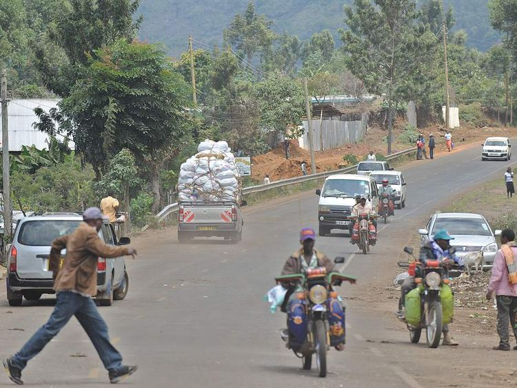 A van driving through a rural town centre transporting khat meant for export to Nairobi fresh from the farm in Kenya's misty central highlands region of Meru.