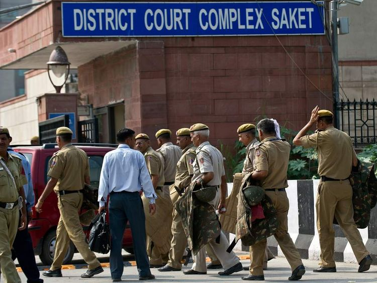 Security outside a court in Delhi where four men guilty of rape and murder were sentenced